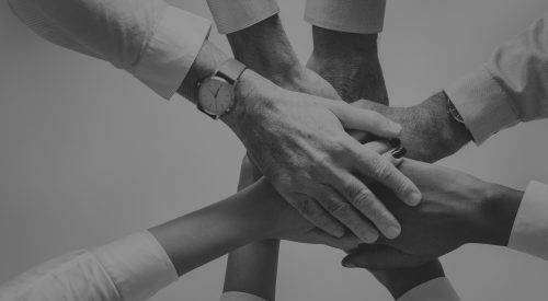Business hands joined together teamwork
